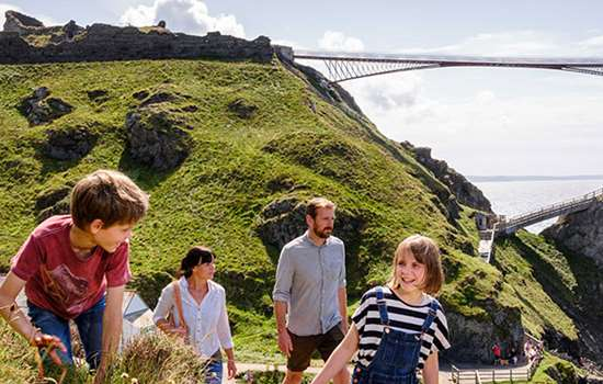 A family explores the new Tintagel Bridge for the first time