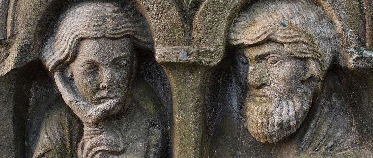 Stone carving of two faces