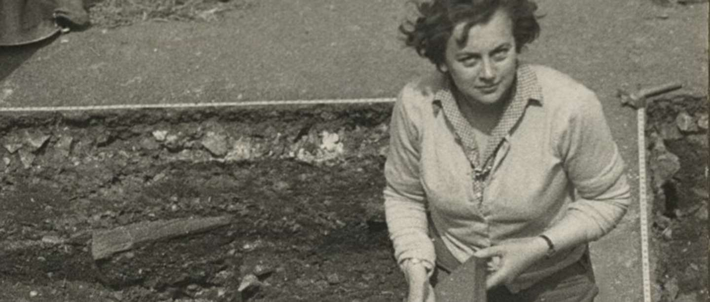 Black and white photography of Rosemary Cramp at an archaeological dig