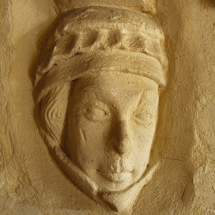 A carved stone head at Christchurch Priory, Dorset, believed to be a portrait of Countess Isabella