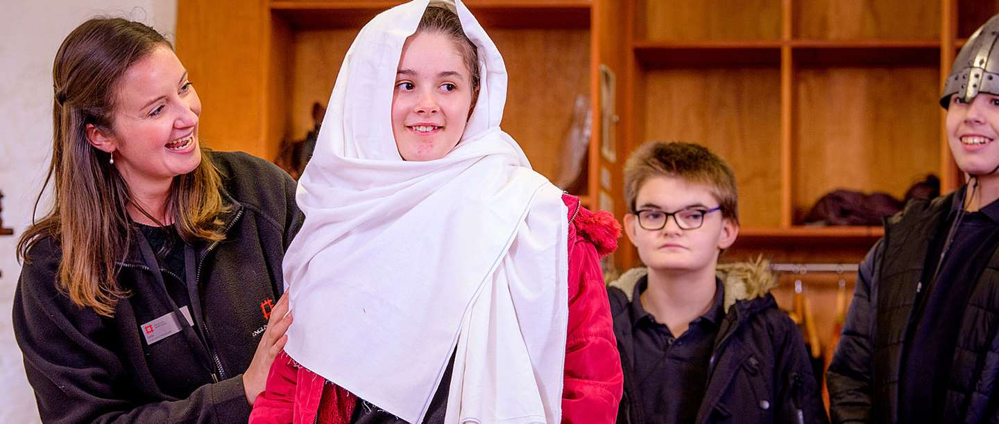 A girl in historical dress learns about history