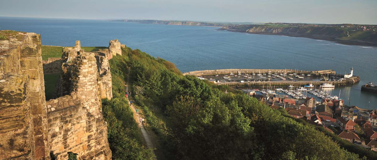 Hillside view of Scarborough castle looking out onto the harbour