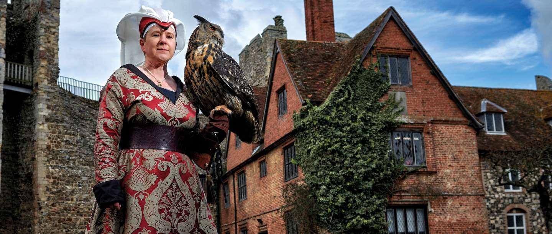 Image: Emma Raphael holding a bird of prey