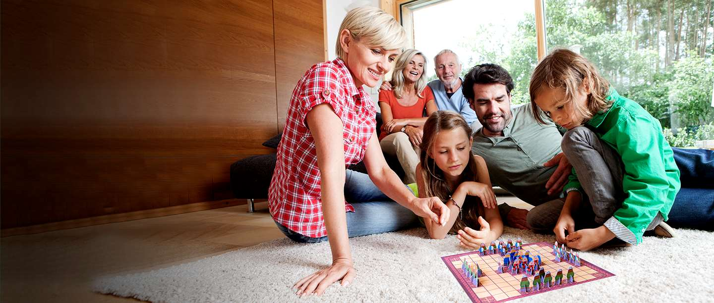 A family playing hnefatafl at home