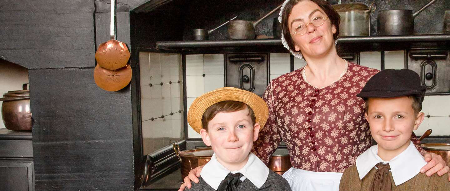 Mrs Crocombe and two young English Heritage members in Victorian period dress