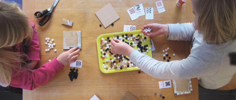 Children making Roman mosaic
