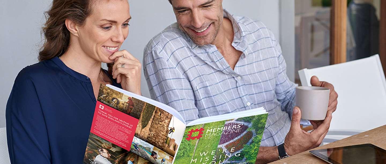 Image: woman and man reading May 2020 Members' magazine