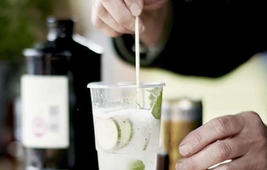 Image: hand preparing gin