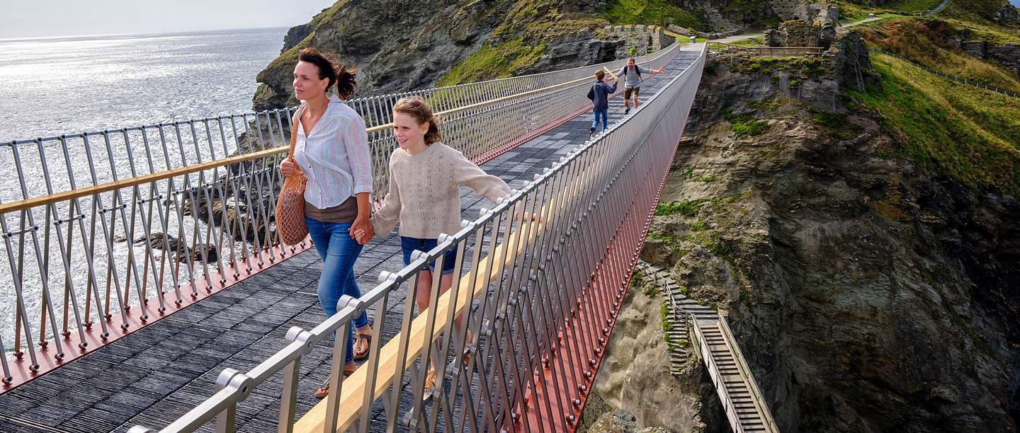 Image: Family on the bridge at Tintagel Castle