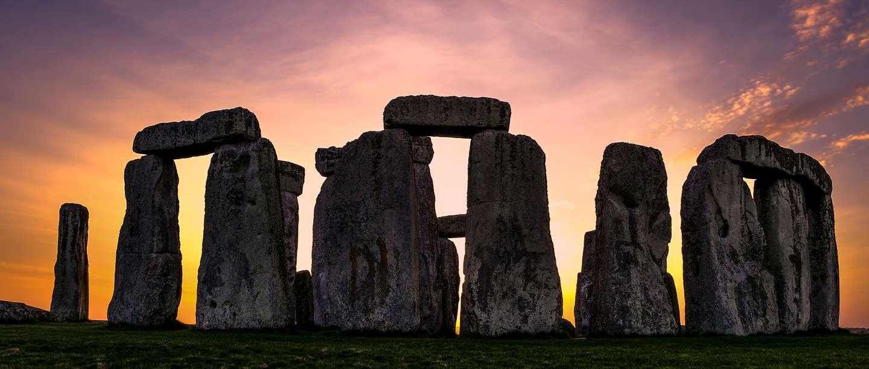 Image: sun setting behind Stonehenge