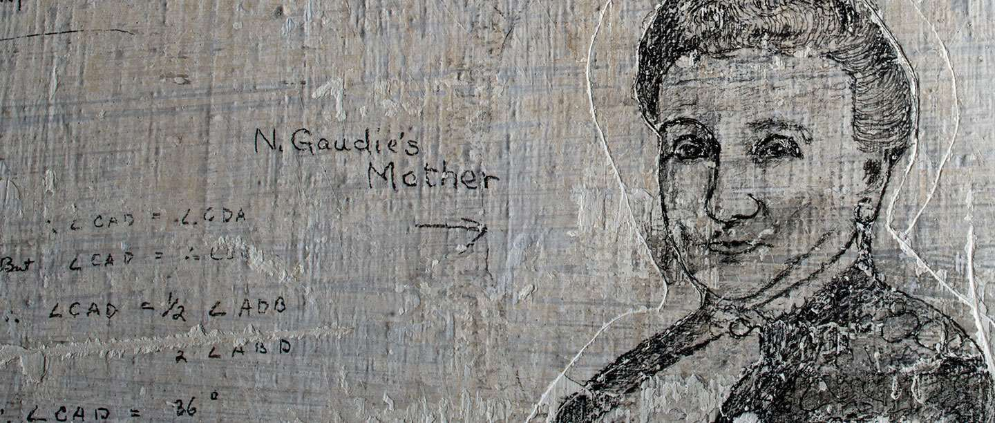 Detail of graffiti portrait of woman etched onto limewashed wall
