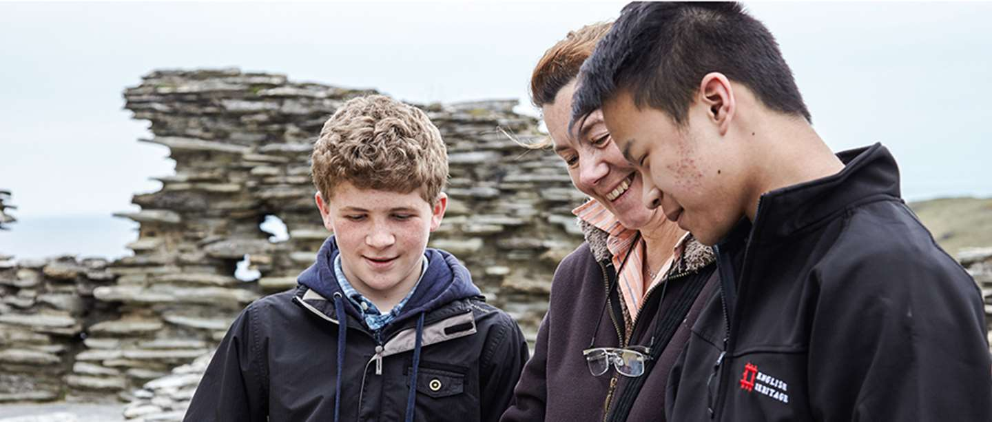 Volunteer with visitors at Tintagel Castle