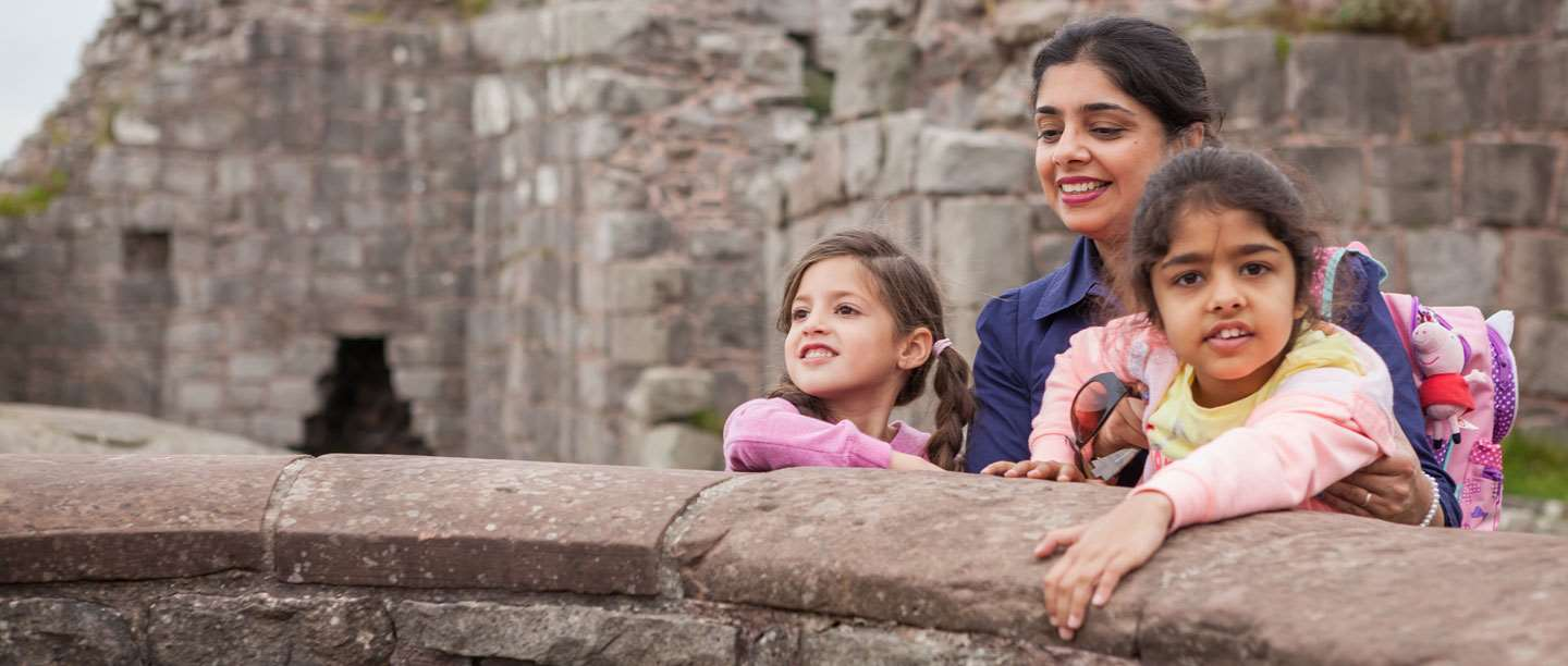 Image: Mother and two daughters enjoying Beeston Castle