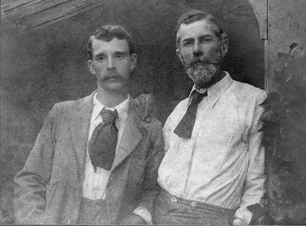 Black and white photograph of George Merrill and Edward Carpenter with Carpenter's hand resting on Merrill's shoulder