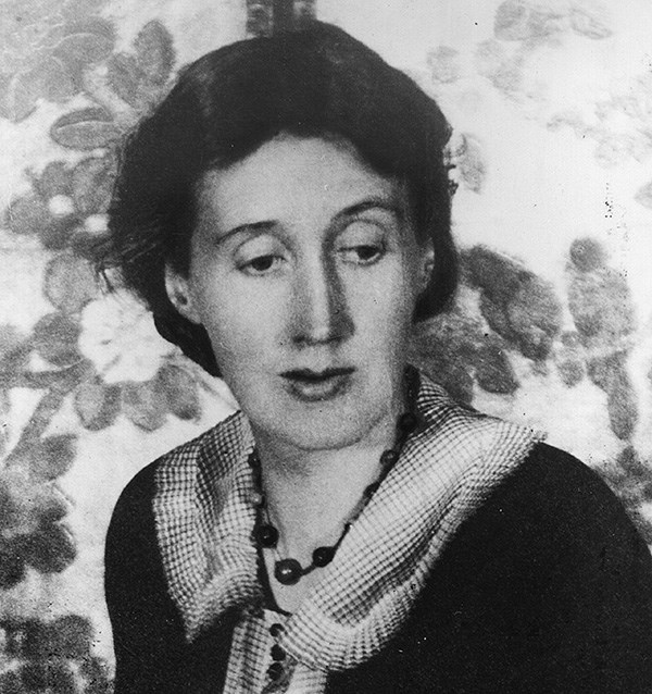 Grainy black and white photograph of Virginia Woolf looking down to the right of frame