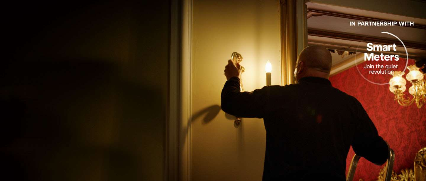Image: Changing a lightbulb at Wrest Park in Bedfordshire