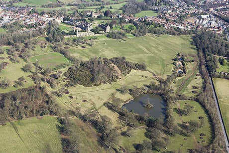 Aerial view of the 1066 Battle of Hastings battlefield, with Battle Abbey in the background