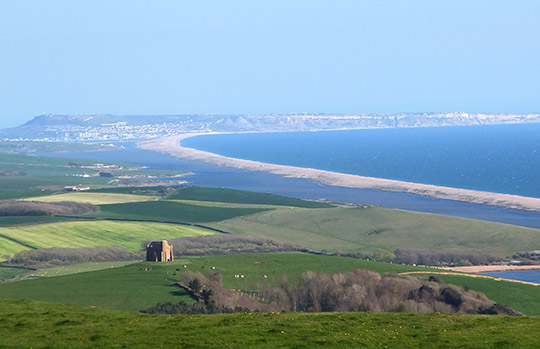 St Catherine's Chapel, looking across Chesil Beach towards Portland Bill
