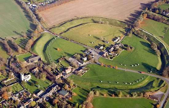 Aerial view of Avebury showing the stone circle, church and neighbouring Alexander Keiller Museum