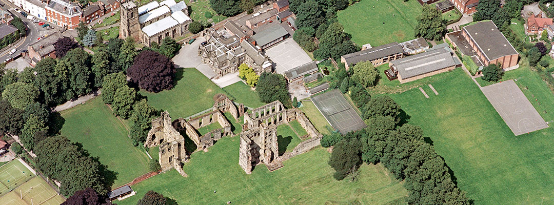 Ashby de la Zouch aerial view, sitting amidst green lawns and mature trees