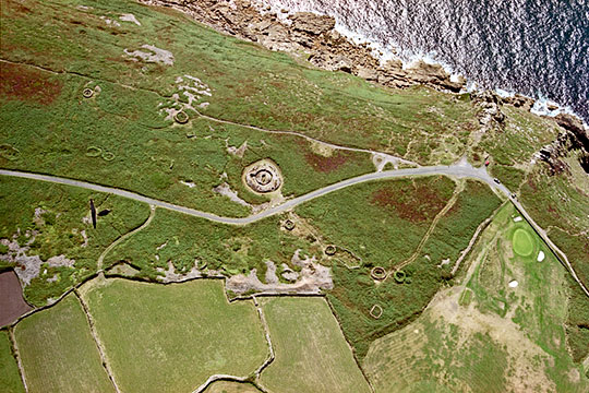 Aerial view of the Bronze Age tomb at Ballowall Barrow, Cornwall, located close to the cliff edge