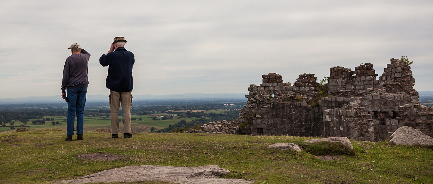 Two visitors enjoying the view at Beeston Castle