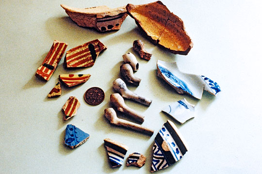 A collection of early small-bowled tobacco pipes and ceramix shreds from Berry Pomeroy