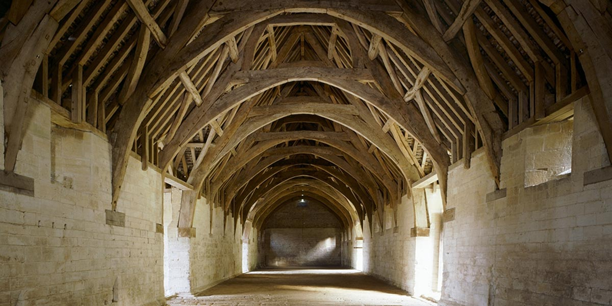The original 14th century roof frame inside the tithe barn