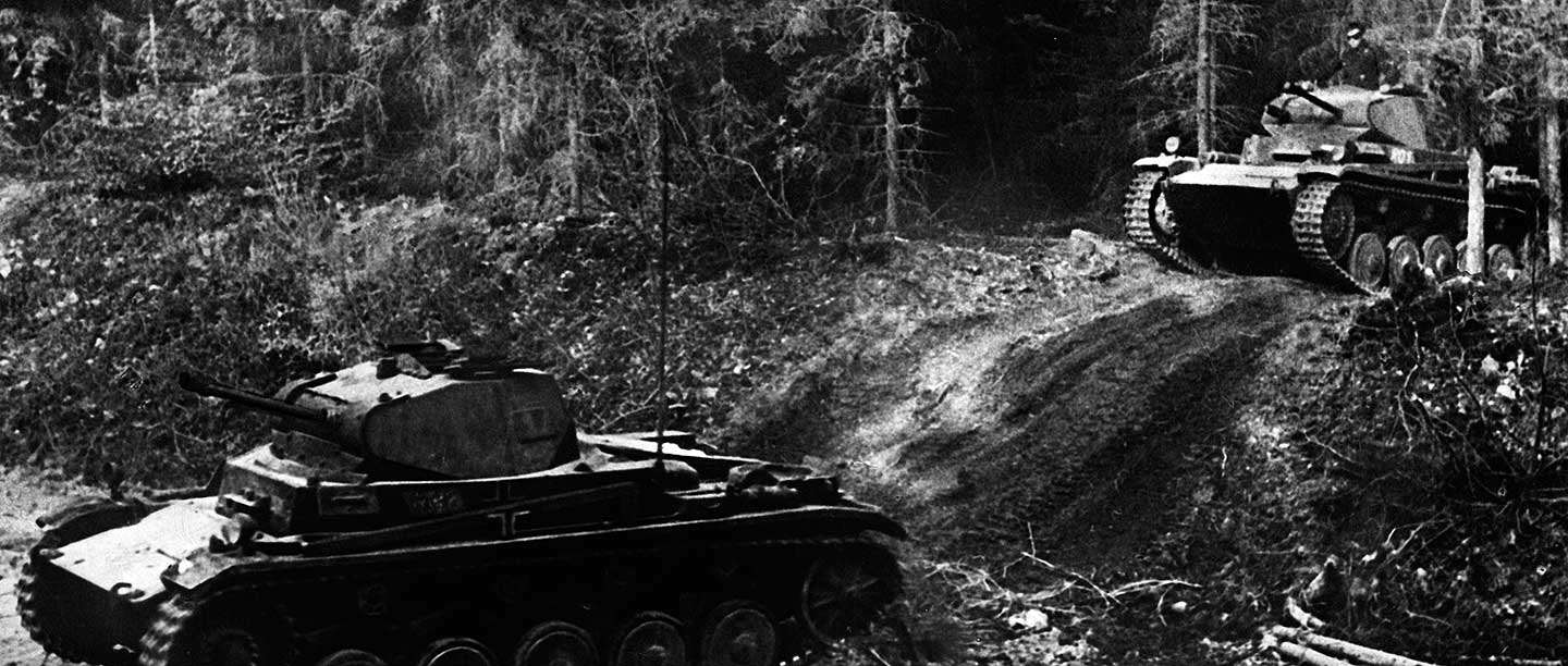 German tanks advancing through difficult terrain in the Belgian Ardennes, May 1940