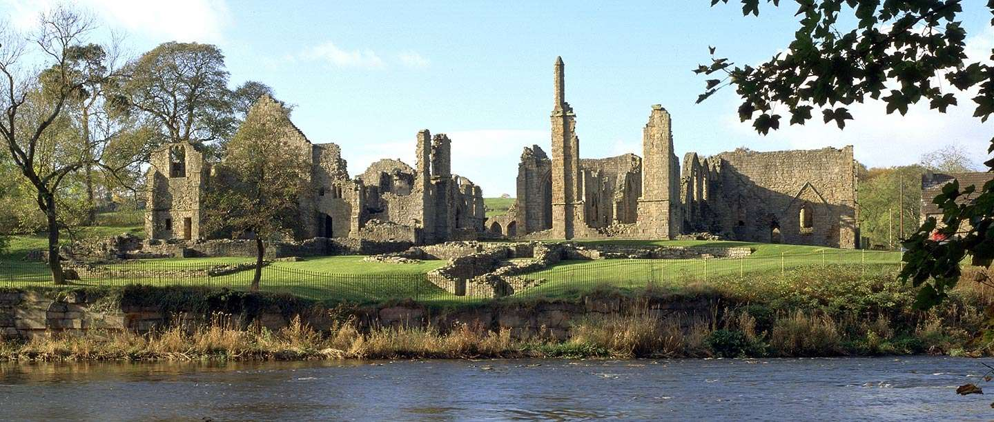 The remains of Finchale Priory seen from across the river Wear