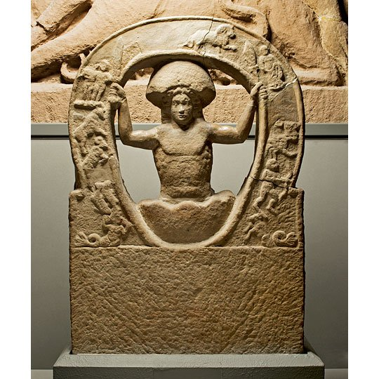 Stone relief from Housesteads Roman Fort showing the birth of the god Mithras from an egg - the symbol of eternal time