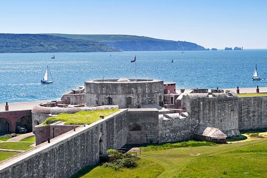 Hurst Castle today, looking south-west towards the Needles Passage and the Isle of Wight, on a clear sunny day with yachts at sea