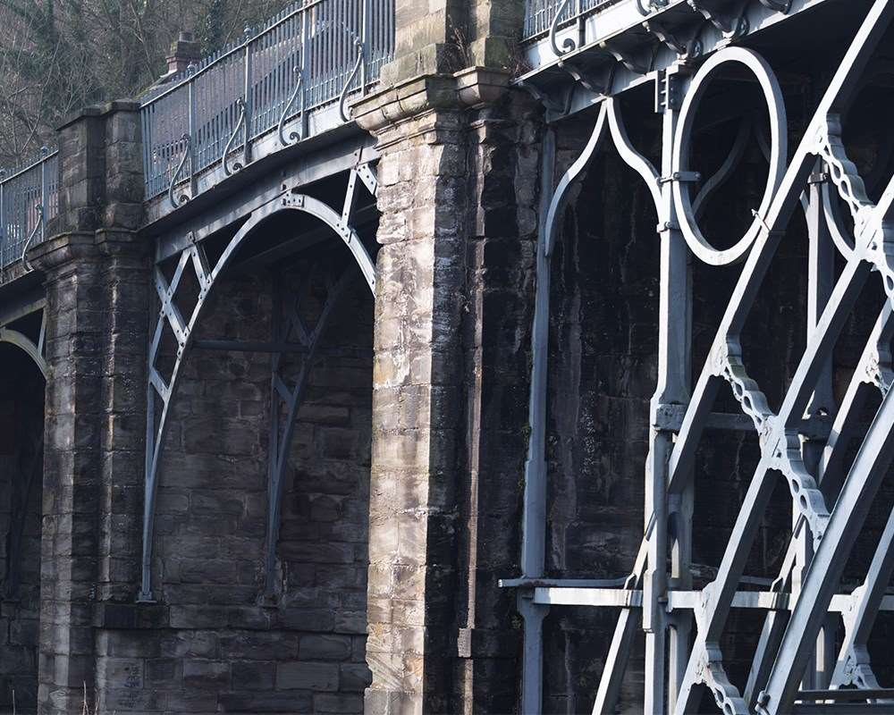 A close up of the iron work and stone abutments