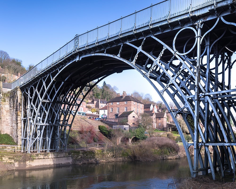 The Iron Bridge from water level with the town behind