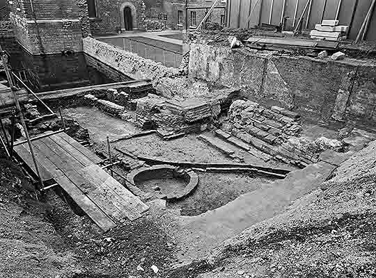 Black and white photograph from November 1962 taken during excavation of the Jewel Tower moat, filled with water at that time