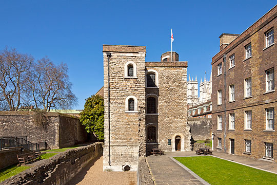 The Jewel Tower from the east, the towers of Westminster Abbey rising behind buildings in the background