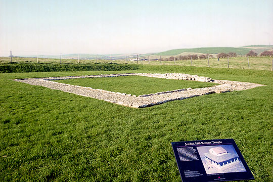 The foundations of the temple with an English Heritage inofrmation board in the foreground