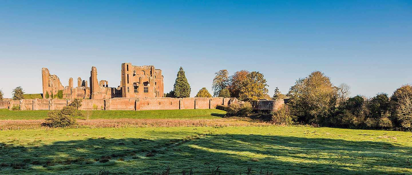 Kenilworth Castle seen from across the mere