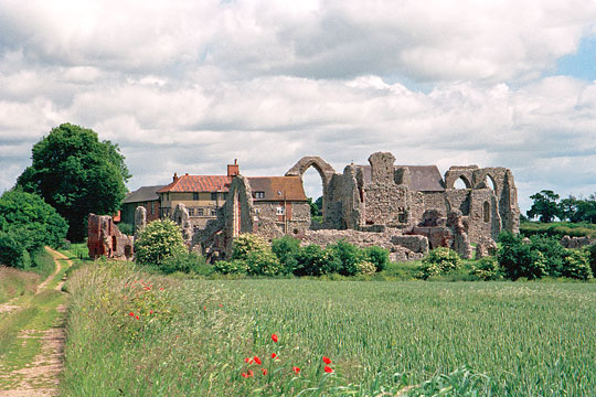 View of the abbey from the south, across a field edged with poppies