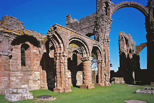 The north nave arcade of the church set in well tended lawn at Lindisfarne Priory