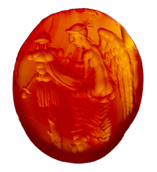 Amber coloured carved gemstone from a ring setting found at Lullingstone Roman Villa, depicting winged victory with armour and weapons