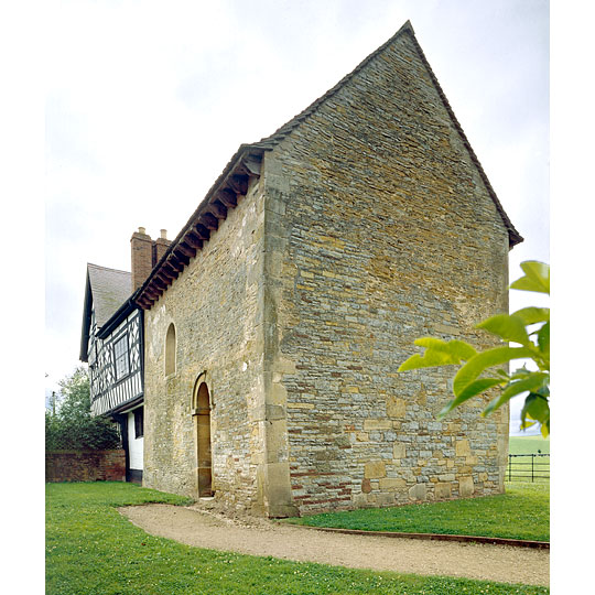 The stone Anglo-Saxon chapel attached to a timber-framed house