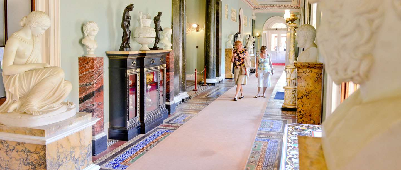 Two people walk through a corridor at Osborne
