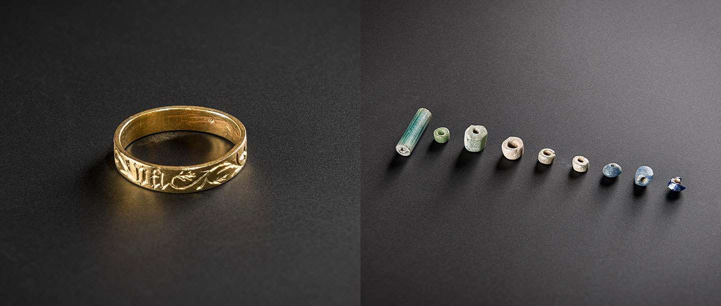 A medieval gold ring (left) and late Roman glass beads (right), excavated at Pevensey Castle, East Sussex