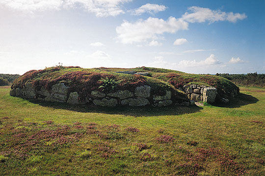 The mound over the burial chamber with its surrounding stone kerb