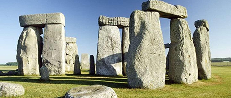 Stonehenge in the daytime against blue sky