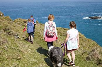 Visitors walking on the cliff top