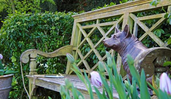 A statue of a royal corgi in the Queen Mother's Garden