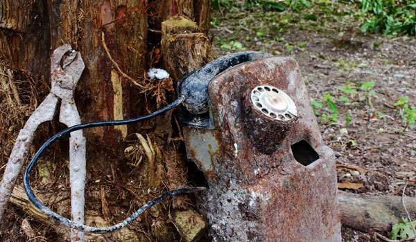A rusted historic phone and shears
