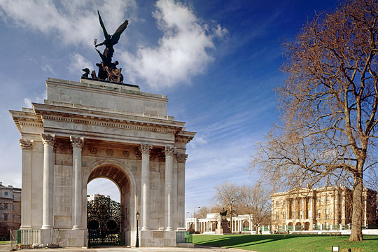 Hyde Park Corner from the east, showing the Wellington Arch, with the Hyde Park Screen, Boehm's statue of Wellington and Apsley House in the background